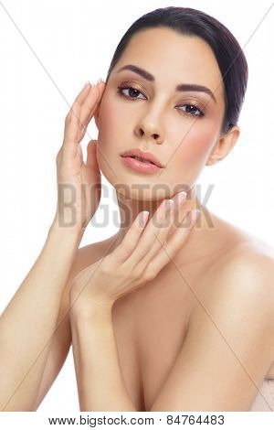 Young beautiful healthy woman touching her face, over white background