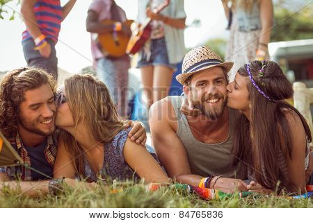 Happy hipsters chatting on the campsite at a music festival