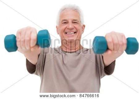 Senior man lifting hand weights on white background
