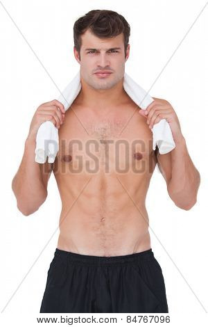 Fit shirtless man looking at camera on white background