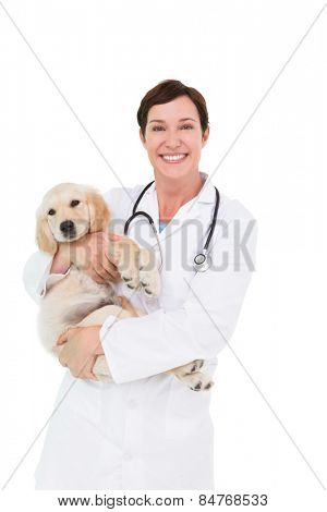 Smiling veterinarian with a cute dog in her arms on white background