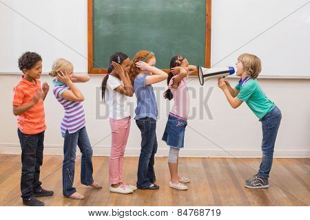 Cute pupil shouting in classroom at the elementary school