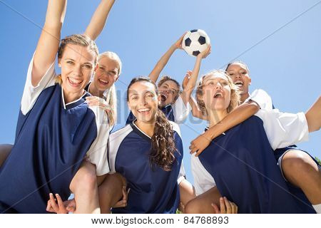 Pretty football players celebrating their win on a sunny day