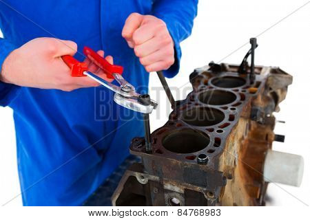 Cropped image of male mechanic repairing car engine on white background