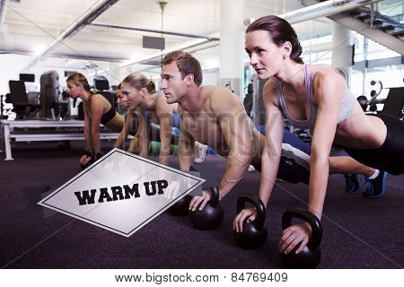 The word warm up and fitness class in plank position with kettlebells against badge