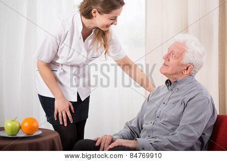 Nurse Caring About Elder Man