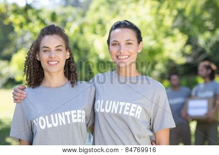 Happy volunteers in the park on a sunny day