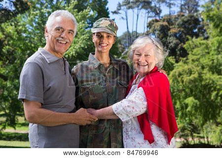 Soldier reunited with her parents on a sunny day