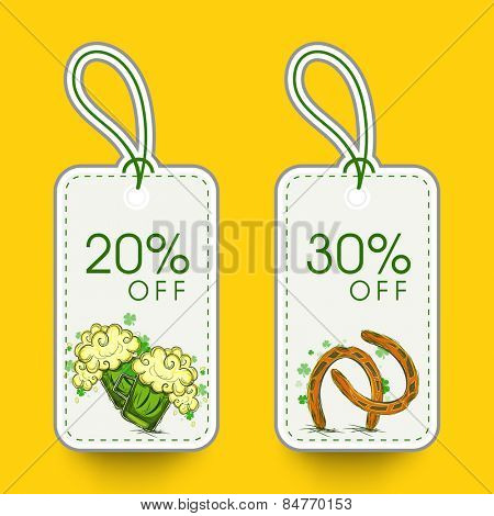 Elegant sale tags with beer mug, horseshoe and discount offer of 20% and 30% for Happy St. Patrick's Day celebration.