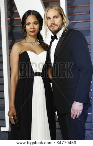 LOS ANGELES - FEB 22:  Zoe Saldana, Marco Perego at the Vanity Fair Oscar Party 2015 at the Wallis Annenberg Center for the Performing Arts on February 22, 2015 in Beverly Hills, CA
