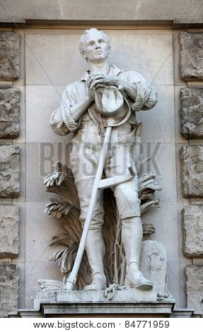 VIENNA, AUSTRIA - OCTOBER 10: Anton Paul Wagner: Liberated Peasant, on the facade of the Neuen Burg on Heldenplatz in Vienna, Austria on October 10, 2014.