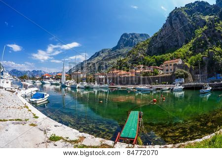 KOTOR, MONTENEGRO - 3 JUNE, 2012: yacht marina is located opposite the Old Town of Kotor, which is located in the south-eastern part of the Bay of Kotor and at the foot of the mountain range of Lovcen