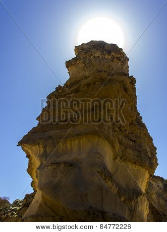 The Sun Behind Sandstone Mountain
