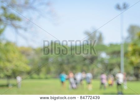 Defocused Background Of Green Park In The City