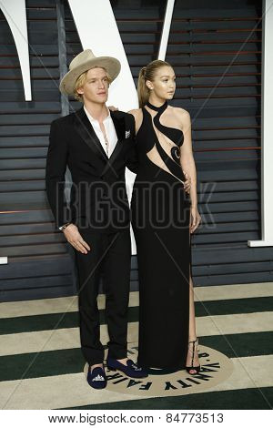 LOS ANGELES - FEB 22:  Cody Simpson, Gigi Hadid at the Vanity Fair Oscar Party 2015 at the Wallis Annenberg Center for the Performing Arts on February 22, 2015 in Beverly Hills, CA
