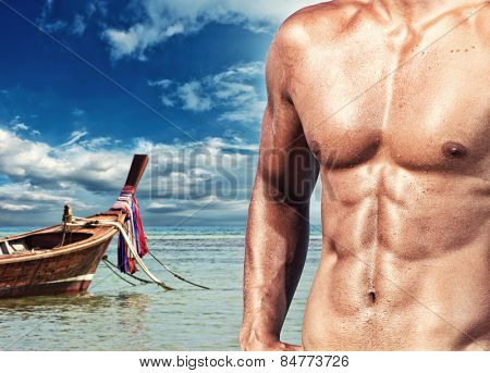 Handsome muscle man on the beach. Thailand.