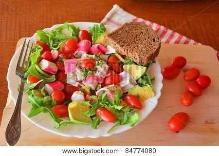 Healthy salad with crabmeat and vegetables