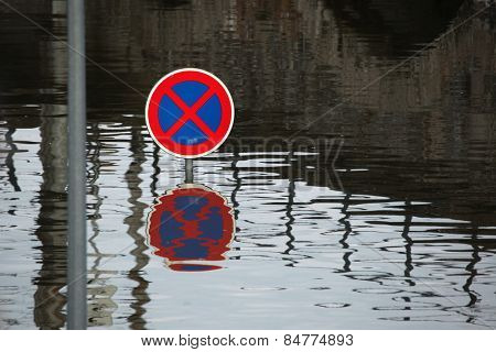 USTI NAD LABEM, CZECH REPUBLIC - JUNE 5, 2013: No stopping, a traffic sign flooded by the swollen Elbe River in Usti nad Labem, Northern Bohemia, Czech Republic, on June 5, 2013.