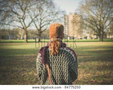 Woman Walking In Park On A Winter Day