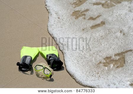 Concept or conceptual snorkeling and swimming gear on sand beach in exotic island for summer, ocean, sea, travel, vacation, sport, tourism, tropical, coast, message, resort, paradise, sunny or water