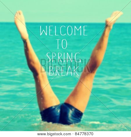 the text welcome to spring break written on a blurred image of a young man upside down into the sea