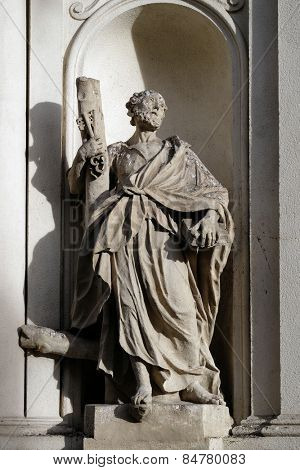 GRAZ, AUSTRIA - JANUARY 10, 2015: Saint Peter the Apostle on the facade of Parish Church of the Holy Blood in Graz, Styria, Austria on January 10, 2015.