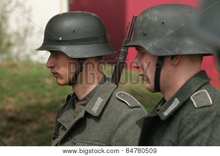 ORECHOV, CZECH REPUBLIC - APRIL 27, 2013: Re-enactors dressed as German Nazi soldiers prepare to stage the Battle at Orechov (1945) near Brno, Czech Republic.