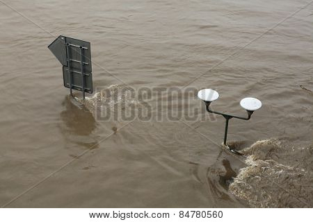 PRAGUE, CZECH REPUBLIC - JUNE 3, 2013: Street lamppost partially flooded by the swollen Vltava River in Prague, Czech Republic.