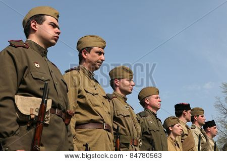 ORECHOV, CZECH REPUBLIC - APRIL 27, 2013: Re-enactors dressed as Soviet soldiers attend the re-enactment of the Battle at Orechov (1945) near Brno, Czech Republic.
