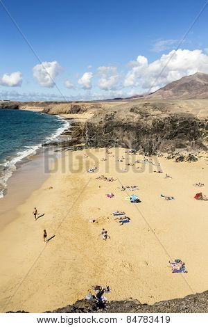 Many Tourists Enjoy Papagayo Beach On A Sunny  Day