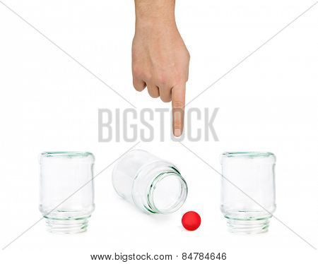 Hand and shell game with glass jars isolated on white background