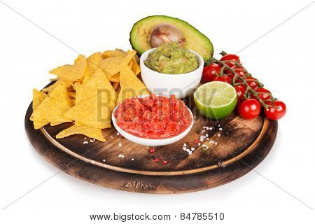 Green Guacamole with nachos and avocado on white background