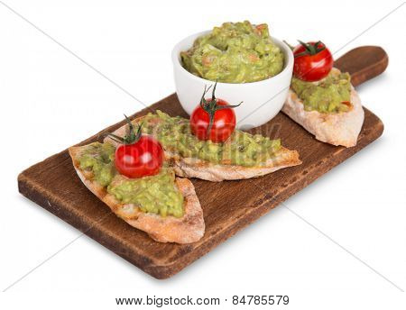 Guacamole with bread and avocado on white background