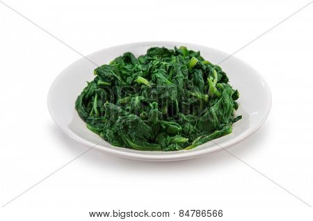 boiled spinach on plate isolated