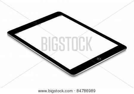 Black Tablet Computer With Blank Screen Mockup Lies On The Surface