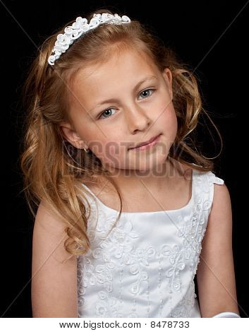 Smiling Young Girl In White Dress On Black