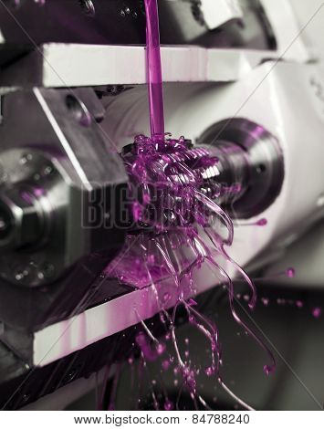 Close up of Pink Floating Fluid in a machine