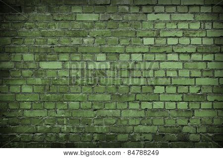 Close up of a Green Worn Brick wall