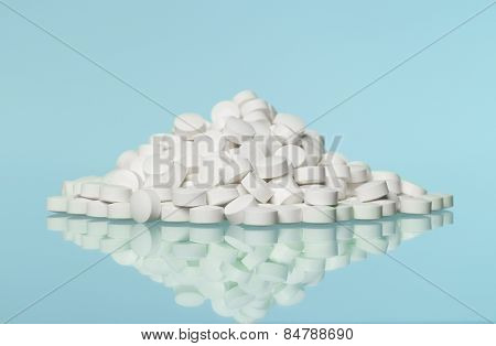 Stack of pills towards blue background