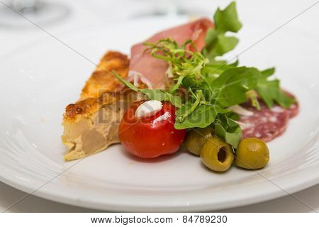 Quiche Olives And Cherry Tomato On Antipasti Plate