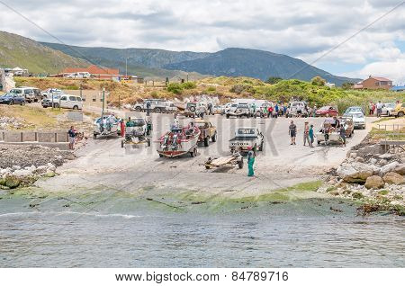 Crayfish Boats And Unidentified People At Kleinmond Harbor