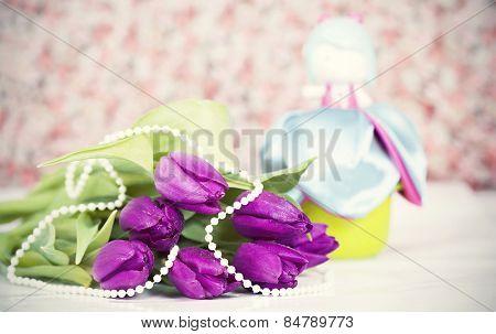 Vintage still life with purple tulips