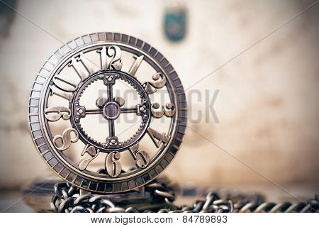 Vintage clock on antique map. Retro still life