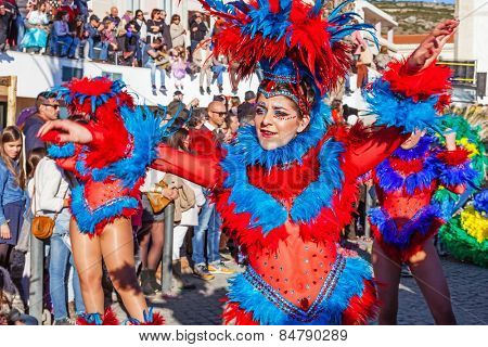 Sesimbra, Portugal. February 17, 2015: Samba dancers members of the Ala Section, in the Rio de Janeiro Brazilian style Carnaval Parade.