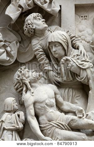 VIENNA, AUSTRIA - OCTOBER 10: Lamentation of Christ Architectural details from the external walls of St Stephen's Cathedral in Vienna, Austria on October 10, 2014.