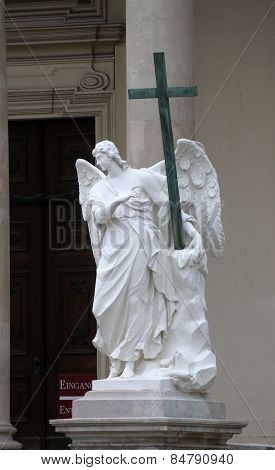 VIENNA, AUSTRIA - OCTOBER 10: Angel statue in front of Karlskirche church in Vienna, Austria on October 10,2011 in Vienna, Austria.