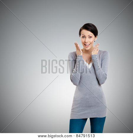 Amazed young girl, isolated on grey