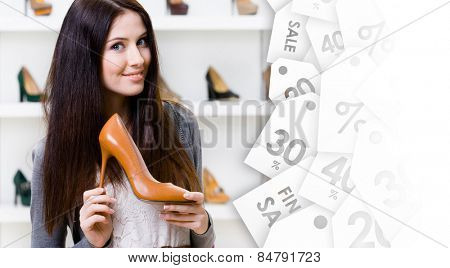 Pretty woman keeping brown leather high heeled shoe on clearance sale in shopping center