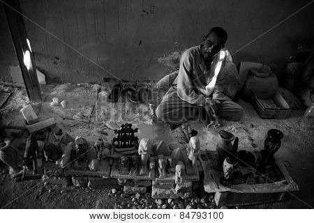 Worker sitting and make handicraft, in Morssey family alabaster shop, black and white