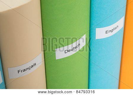 Close-up Of Different Language Books
